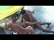 Beach threeway mfm filmed by a voyeur wild gang sex in public